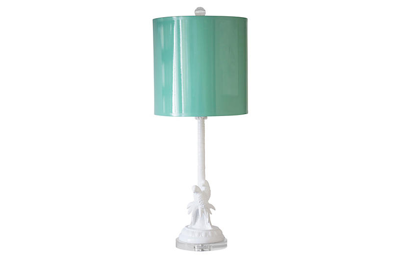 Parrot palm lamp with aqua shade and white stand and base featuring parrots.