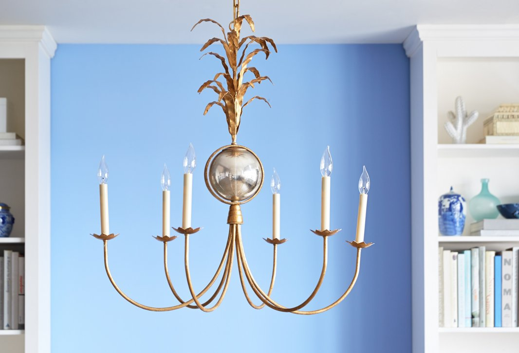 With leafy accents and candle-inspired lights, Visual Comfort's Gramercy Chandelier makes an elegant statement.