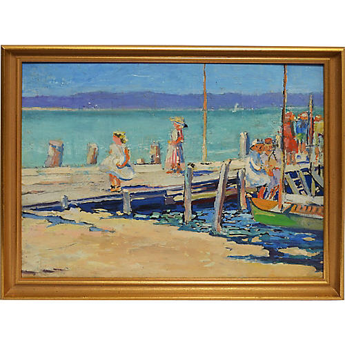 View of Figures on a Beachside Dock